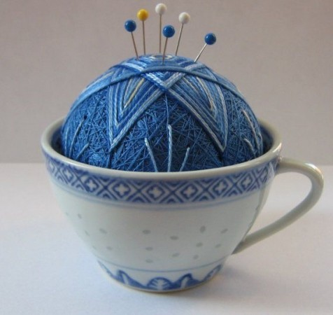 Teacup pin cushion.