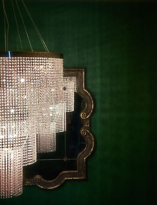 Emerald wallpaper behind glamorous crystal chandelier (fashiongonerogue).