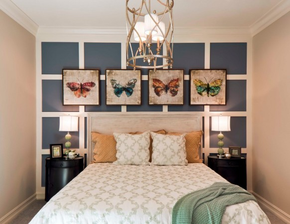 Butterfly artwork enhances this bedroom design