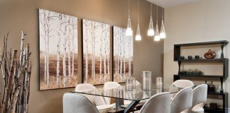 Birch tree paintings and branches accent this dining room