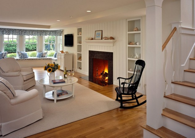 A classic rocking chair flanks the fireplace