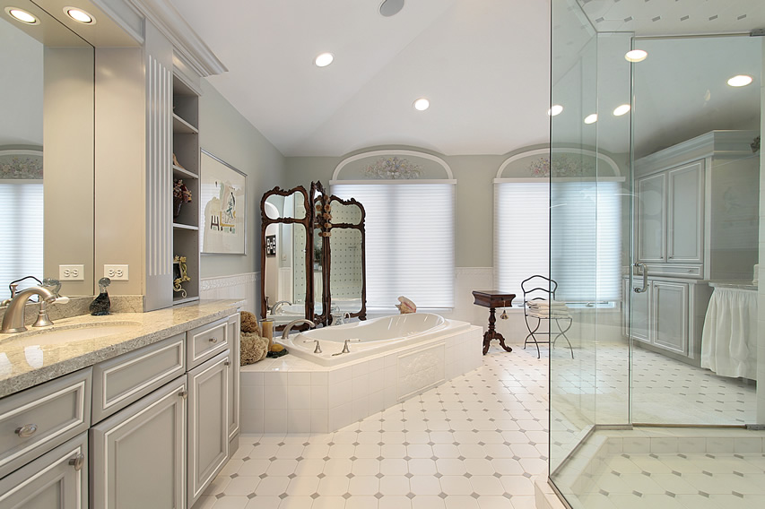 Luxury bathroom designs incorporate a lot of marble, woodwork, and custom tiles in their walls, floors and furnishings