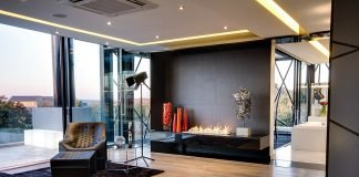 A blend of actual sculpture and sculptured furnishings bring interest to this room