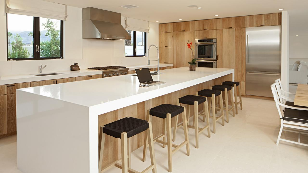 Clean Lines In This Kitchen With Waterfall Countertops