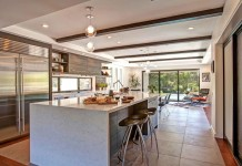Open kitchen with waterfall countertops