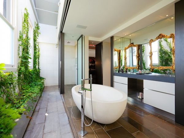 Nature and a view add to this luxury bathroom