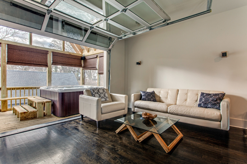 Loft interior sectional glass garage door livinator - The apartment in the garage a splendid parisian transformation ...