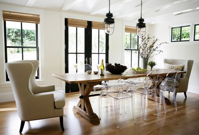 Lucite chairs enhance this wood table