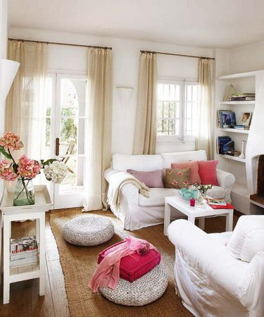 White furniture and slipcovers create a fresh summery space