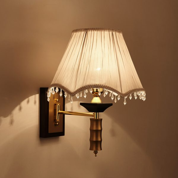 Delicate sconce light, perfect for a reading corner or at bedside