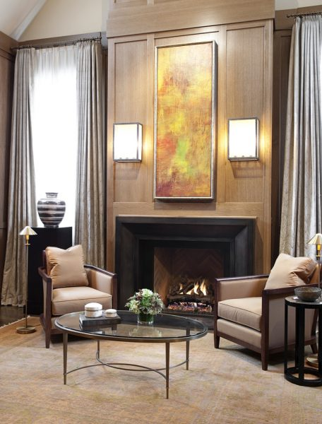 Fireplace is flanked by modern sconces