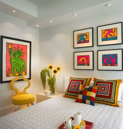 Artwork and accessories bring bright color to this bedroom