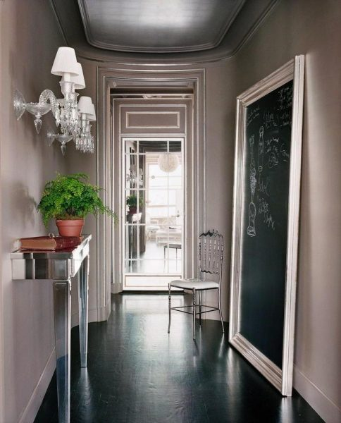 Decorative sconces add style to the hallway