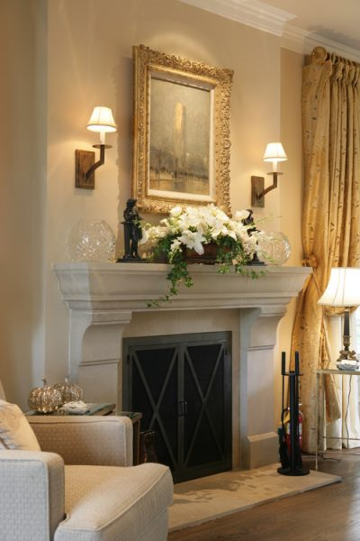 Sconces highlight the fireplace mantel