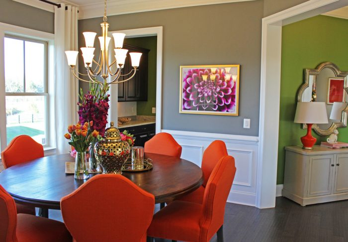 Bold orange chairs bring life to this dining room