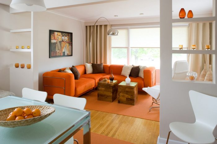 An orange sofa gives this room a boost of color