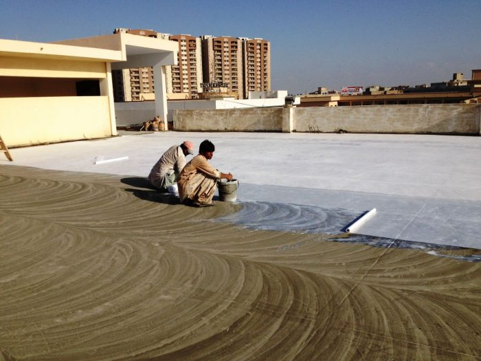 Roof insulation coating technique in two stages