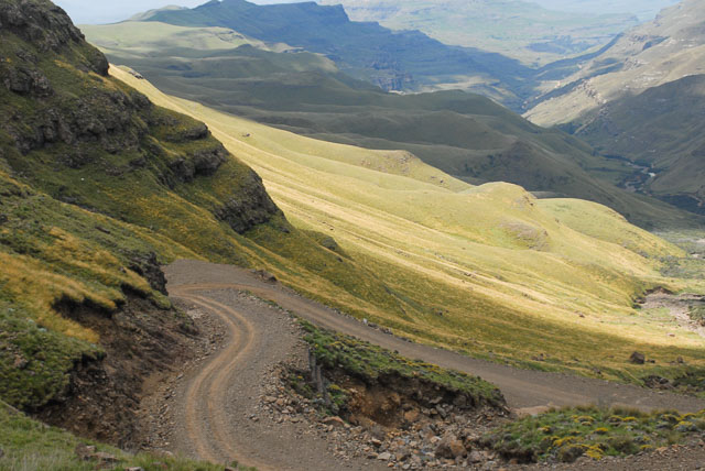 Winding gravel road through hills, Sani Pass, South Africa road trip