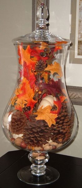 Fill apothecary jars with fall leaves to add height to a table. http://www.thebudgetdecorator.com