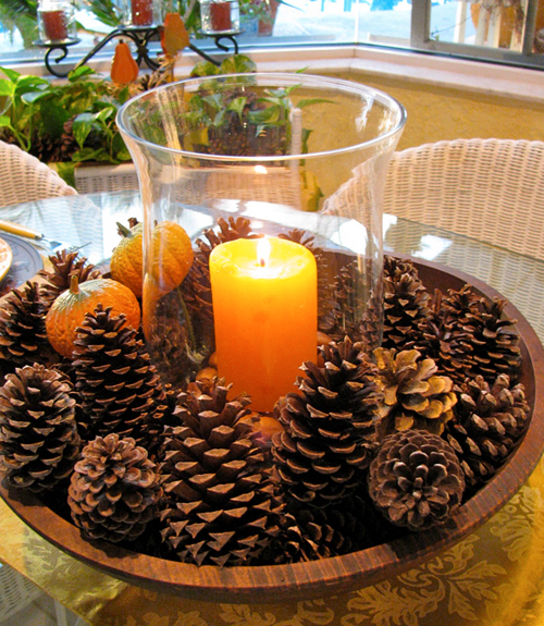 Because of the orange candle, this pine cone display doesn't appear Christmas-y.  http://www.countryliving.com