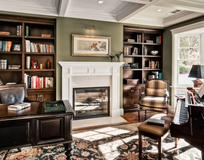 Built-it shelving and a gas log fireplace add elegance to an office.