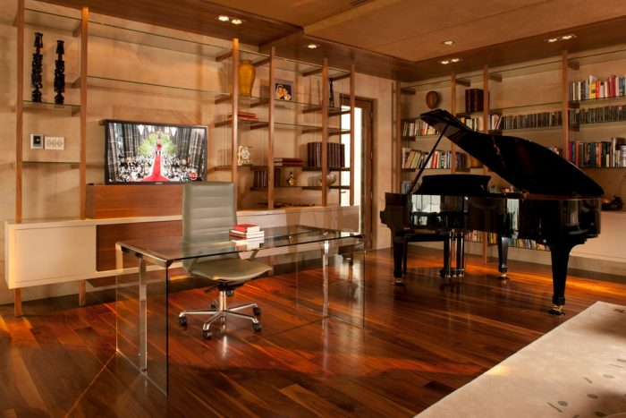 Home office with modern desk. Indeed, the focal point is the grand piano.
