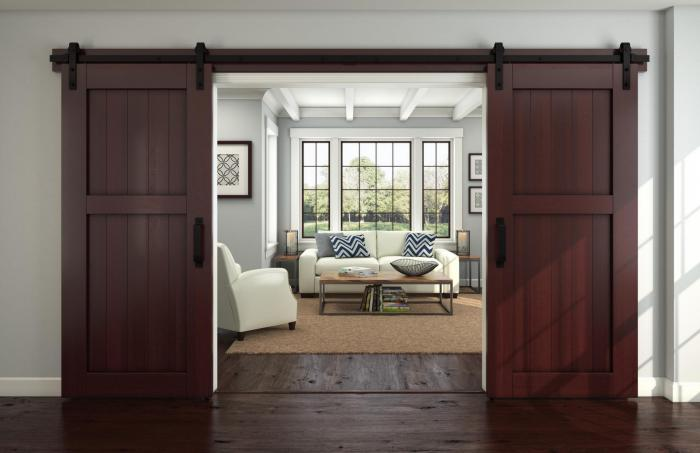 Rolling barn doors make a grand entry into the living room