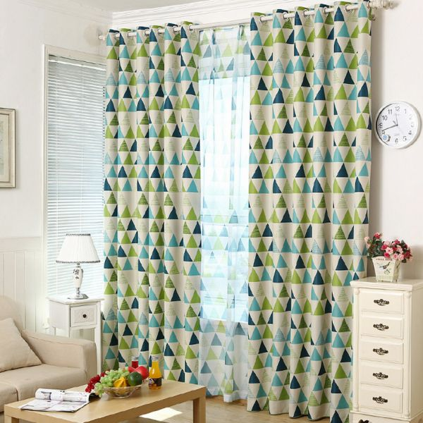Geometric curtains sweep the eye vertically. This can make a small room feel grander.