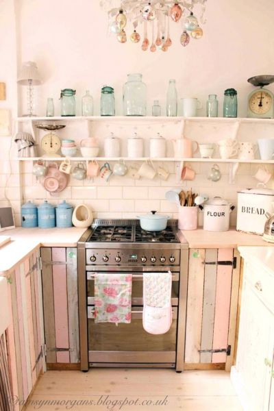 Holy pink! I love this rustic pink kitchen. It's fun and unexpected and the simple open shelving is amazing. Love the glass accessories