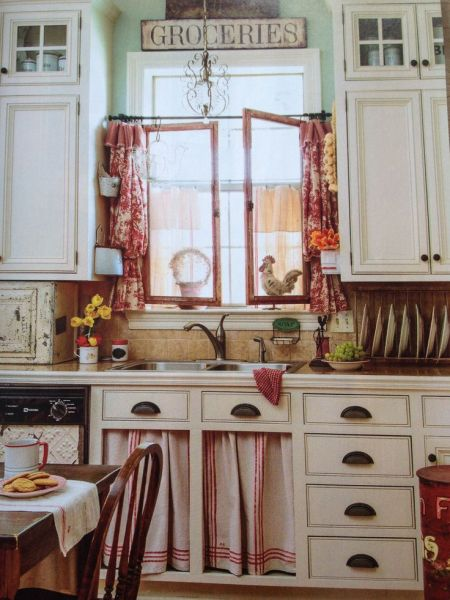 Because of the red throughout, the rooster theme works! I love the tea towel curtains to replace the cabinet fronts.