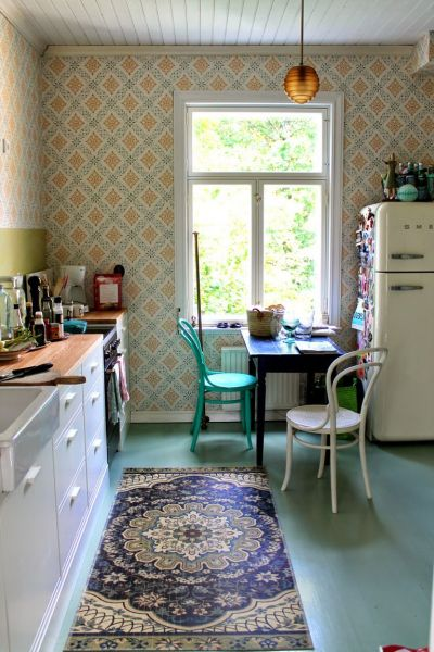 The cozy wallpaper pattern is fun and adds color. I love the vintage fridge.