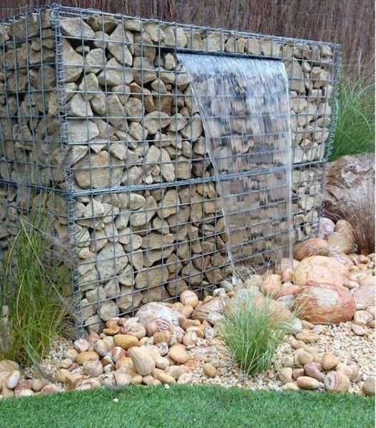 Create a gabion wall water feature.