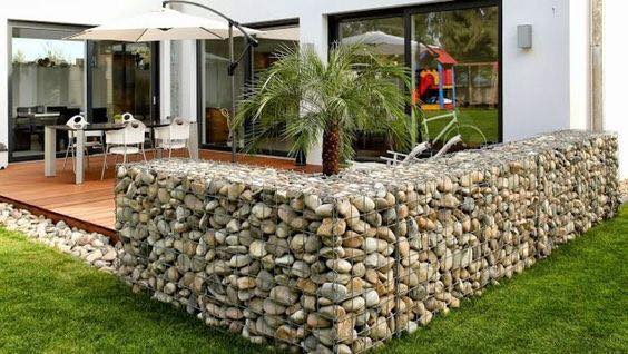 Because of the mix of modern metals and classic stone, gabion walls are a popular way to enhance your patio.