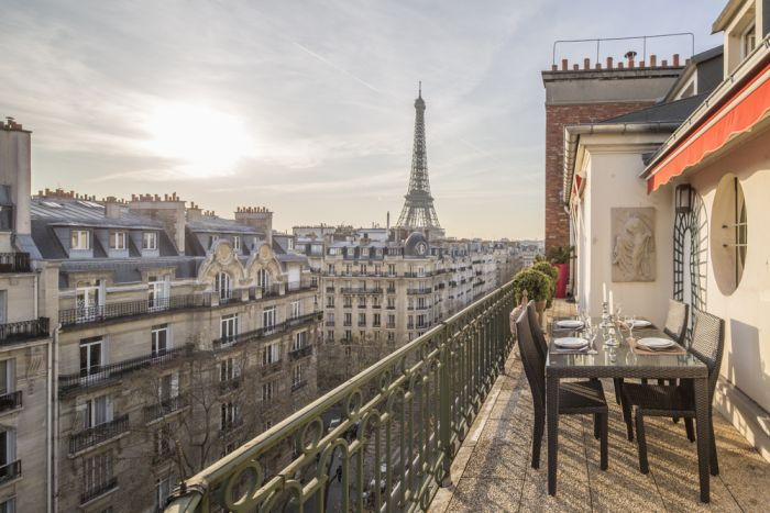 See the Eiffel Tower view from this apartment balcony?