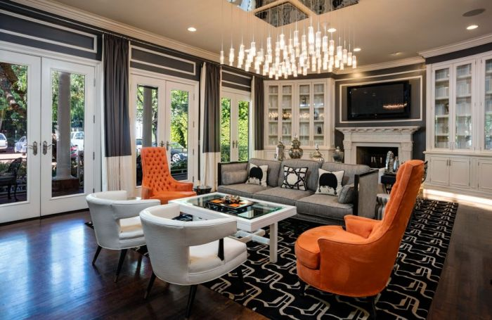 Pops of orange complement this gorgeous room (businessinsider.sg)
