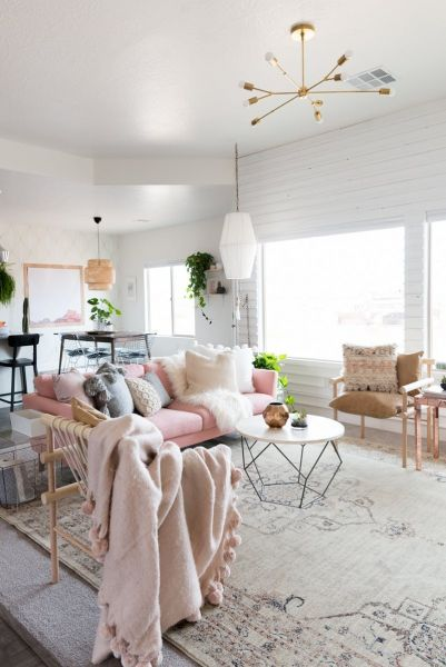 Adding texture with pillows, throws and rugs give a pastel room more depth. (Covetedition.com)