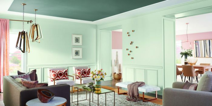Pale green walls highlight, while tones of blush enhance this space. Metal furniture, accessories and lighting add texture and weight. (Elle Décor)