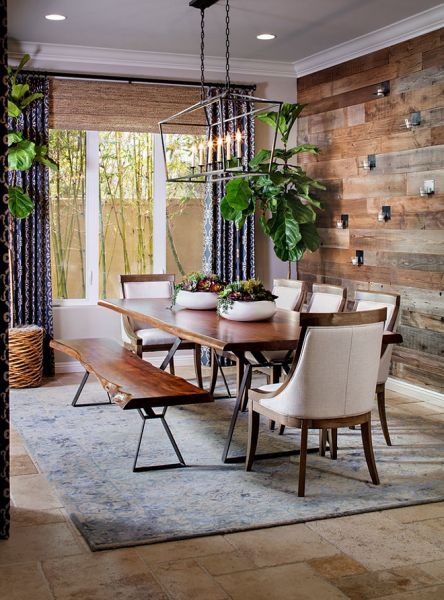 A weathered wood accent wall gives this dining room natural appeal (homebunch.com)