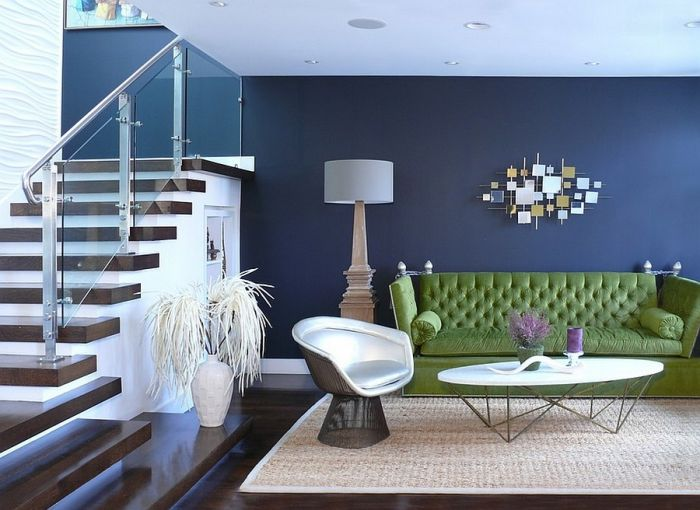 A green sofa complements the blue of this space (interiordesign2014.com)