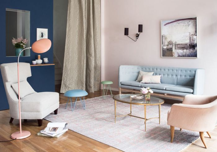 This pastel room is grounded with a dark blue wall. (laurelandwolf.com)
