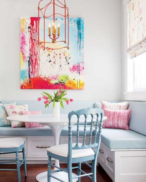 Colorful artwork makes a statement in a pastel room. (lushome.com)