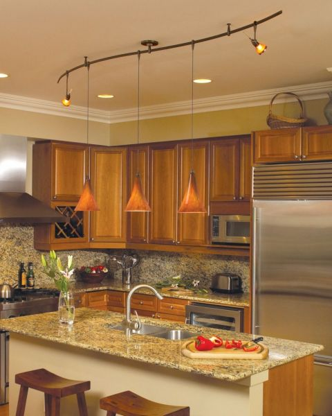Pendant lights with colorful glass shades are always a welcome sight in the kitchen (midcityeast.com)
