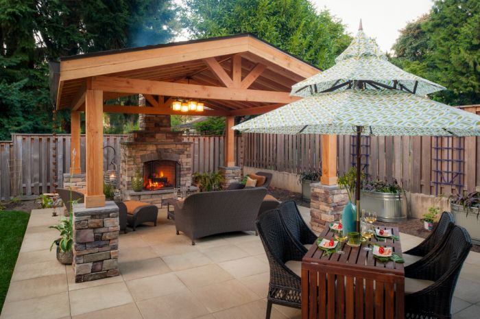 Adding an outdoor fireplace makes for a cozy spot for relaxing and entertaining (patiodesign.info.com)