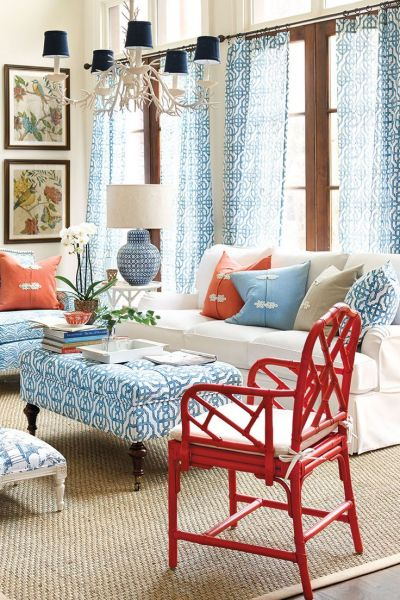 A red chair adds a pop of color to this blue and coral room (Pinterest.com.au)