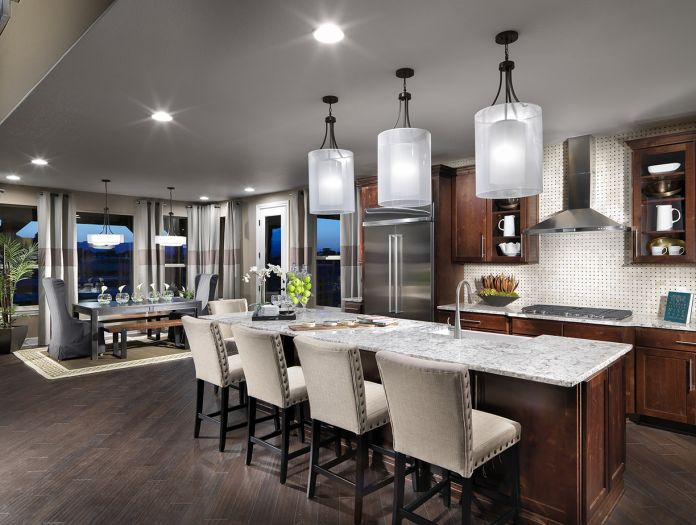 There are many beautiful fixtures to choose from when selecting lighting for your kitchen island (progresslighting.com)