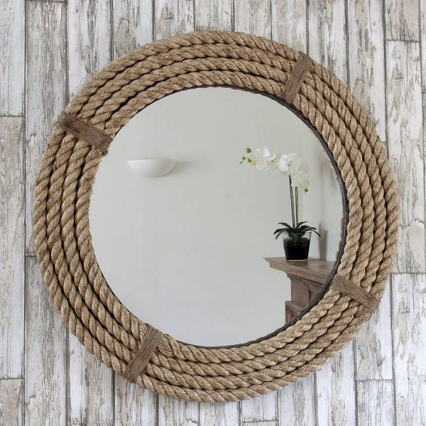 round mirror with a metal frame while using a nautical rope