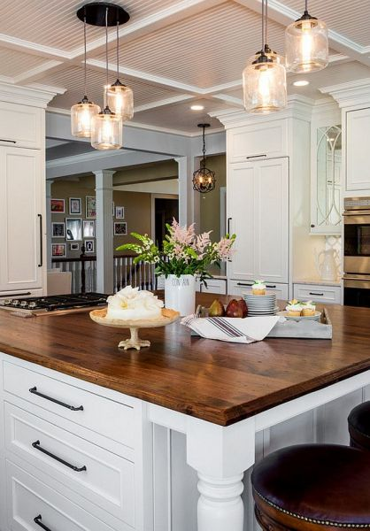 Pendant light clusters are a beautiful addition to this kitchen island