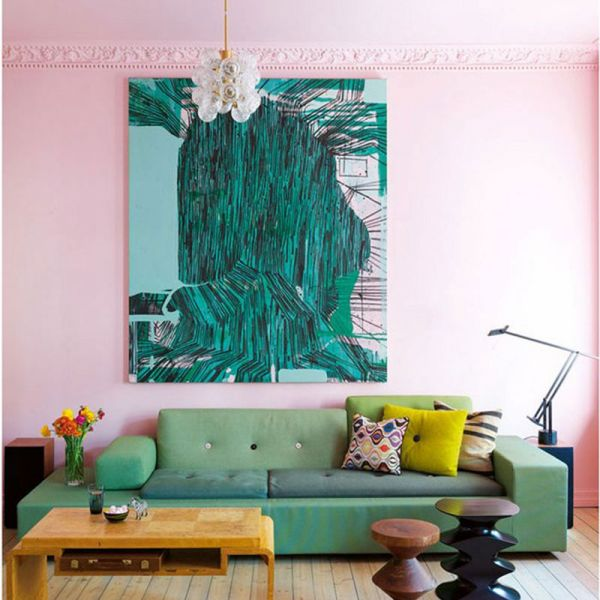 A pink pastel wall gets a statement focal point with artwork. (sophierobinson.co.uk)