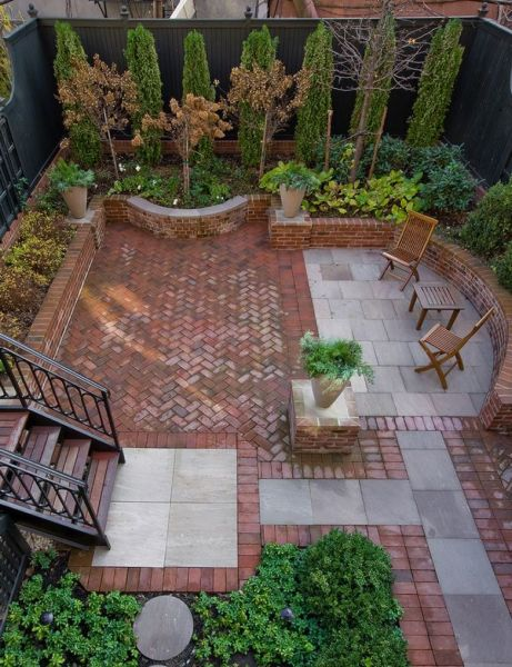 Traditional brick patio with stone insets creates and welcoming place to relax and entertain (stewiesplayground.com)