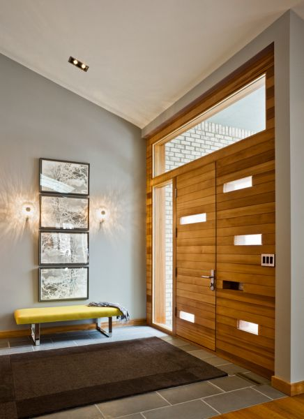 Gorgeous wood doors warm this space (tophomedoor.com)